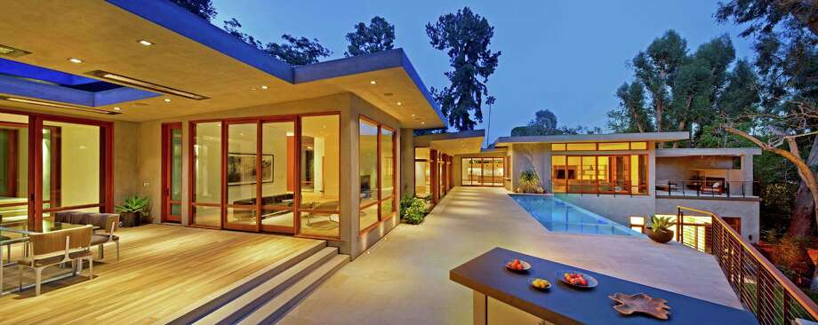 Ricky Martin paid $13.5 million for a seven-bedroom home on three quarters of an acre in Beverly Crest. Originally designed by architect Gregory Ain for his psychiatrist, Fred Feldman, the Midcentury Modern-style home was recently renovated and expanded to 11,300 square feet of living space Among details of note are walls of wood-paneled windows, an oversized master suite and an infinity-edge swimming pool. (Bill Singleton) Photo: Bill Singleton / Los Angeles Times
