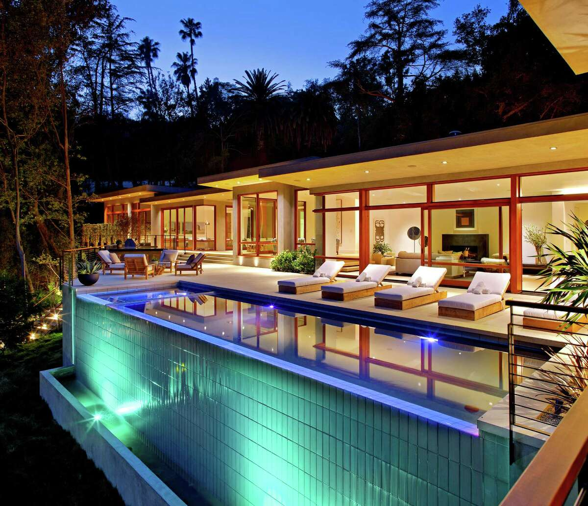 Ricky Martin paid $13.5 million for a seven-bedroom home on three quarters of an acre in Beverly Crest. Originally designed by architect Gregory Ain for his psychiatrist, Fred Feldman, the Midcentury Modern-style home was recently renovated and expanded to 11,300 square feet of living space Among details of note are walls of wood-paneled windows, an oversized master suite and an infinity-edge swimming pool. (Bill Singleton)