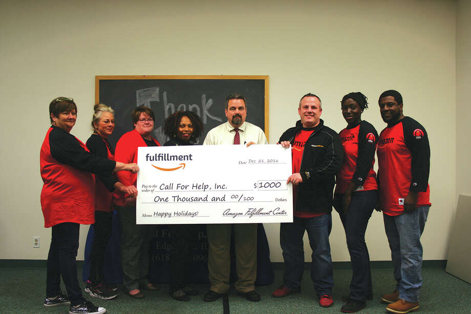 Amazon's Jason Speedy, the general manager of the Edwardsville fulfillment center, presented Call for Help, Inc. with a $1,000 cash donation.  The East St. Louis-based Call for Help empowers people to overcome a variety of personal crises, ranging from sexual assault and poverty, to homelessness and mental illness.  The donation is part of Amazon's ongoing commitment to giving back in communities where its associates live and work. Shown left to right are Pam Rosterman and Ramona Sabby from the Edwardsville fulfillment center, Melissa Tutterow, Melinda Nicholson and James Kellerman from Call for Help, and Jason Speedy, Tiffany Carver and Darrick Collier, also from the Edwardsville fulfillment center.  The fulfillment center employs more than 1,000 area residents. Photo: For The Intelligencer