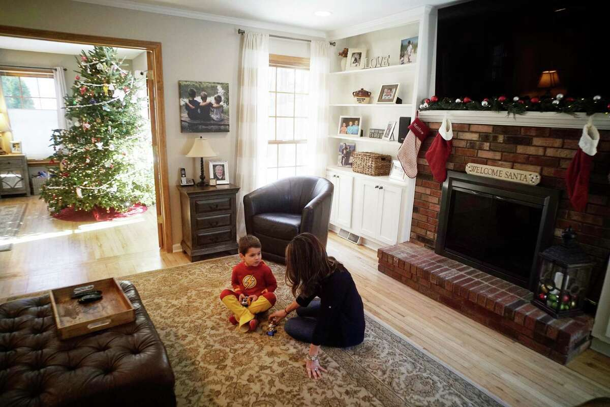 Kristy Duddy and her son Dylan, 5, play on the floor at their home on Wednesday, Dec. 14, 2016, in Clifton Park, N.Y. The couple is selling their home through Gucciardo Real Estate Group. (Paul Buckowski / Times Union)