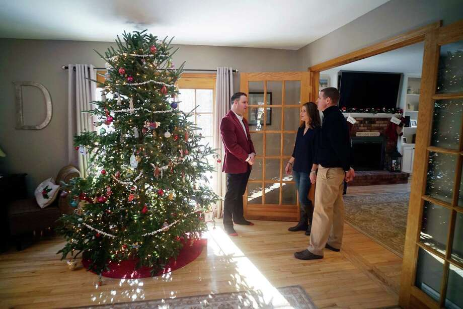 Broker, Anthony Gucciardo, left, president of Gucciardo Real Estate Group, talks with clients, Kristy Duddy and her husband Matt Duddy at their home on Wednesday, Dec. 14, 2016, in Clifton Park, N.Y.  The couple is selling their home through Gucciardo Real Estate Group.    (Paul Buckowski / Times Union) Photo: PAUL BUCKOWSKI / 20039098A