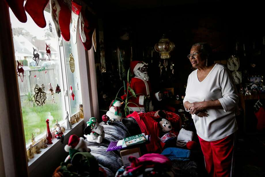 Clarice Patterson looks out the window of her Pacifica home filled with decorations for the holidays. Photo: Gabrielle Lurie, The Chronicle
