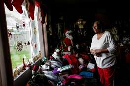 Clarice Patterson looks out the window of her home in Pacifica, Calif., on Tuesday, Dec. 20, 2016.