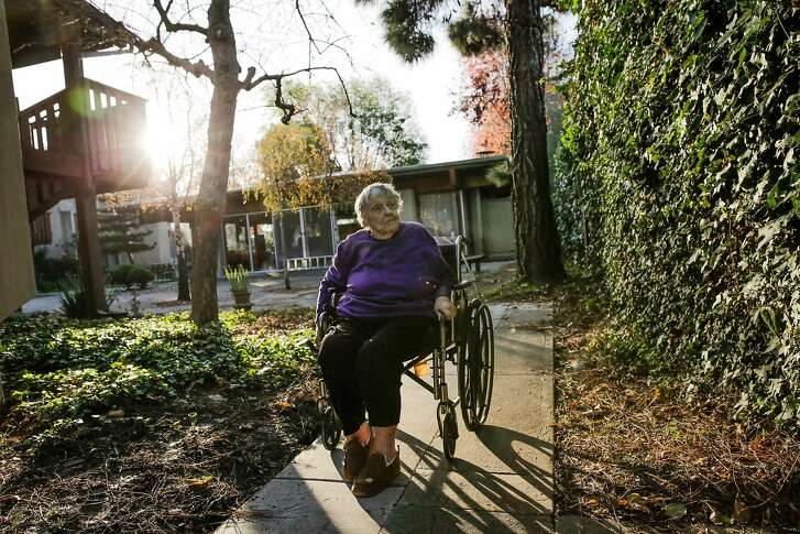 Lynnie Rayburn, a senior who participates in group phone calls for the elderly, takes her morning stroll in Berkeley, Calif., on Monday, Dec. 19, 2016.