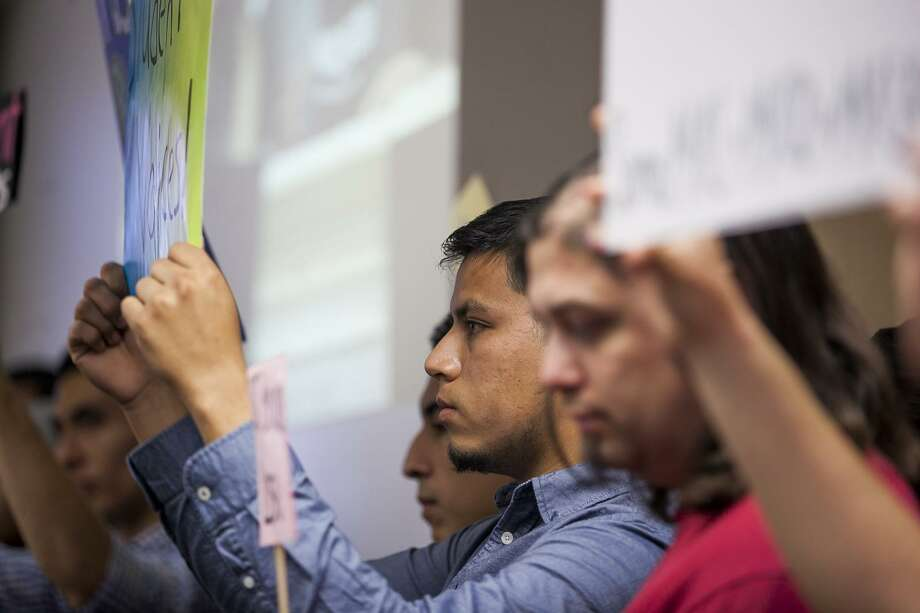 """Alamo Colleges students and faculty members in March 2015 call for the dismissal of the college district's chancellor, Bruce Leslie. A book, """"The 7 Habits of Highly Effective People,"""" sparked an accreditation problem for some schools in the system and has added to Leslie's woes. Photo: San Antonio Express-News File Photo / Julysa Sosa For the San Antonio Express-News"""