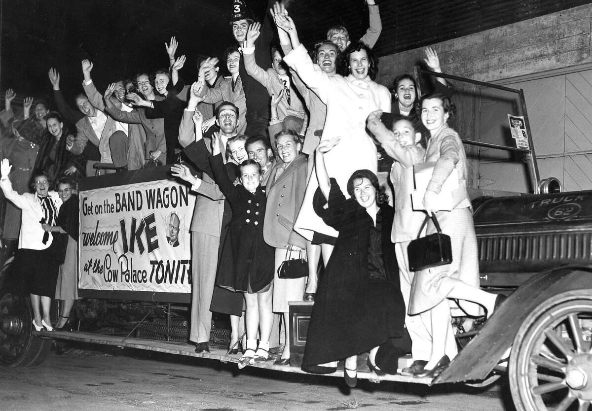 Dwight Eisenhower supporters join a bandwagon to the Cow Palace. Oct. 8, 1952.