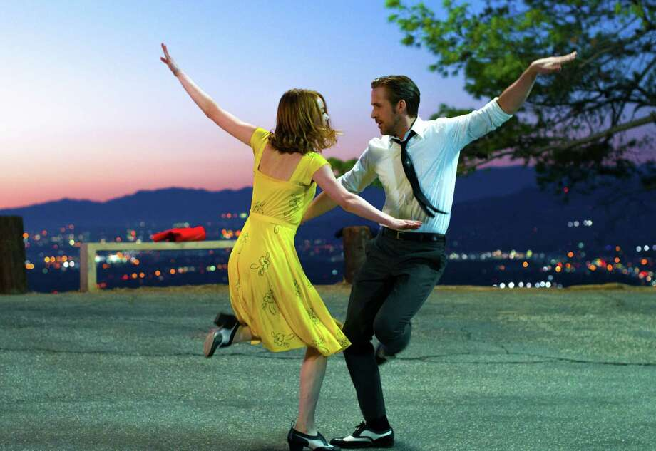 "This image released by Lionsgate shows Ryan Gosling, right, and Emma Stone in a scene from, ""La La Land."" (Dale Robinette/Lionsgate via AP) ORG XMIT: NYET422 Photo: Dale Robinette / Lionsgate"
