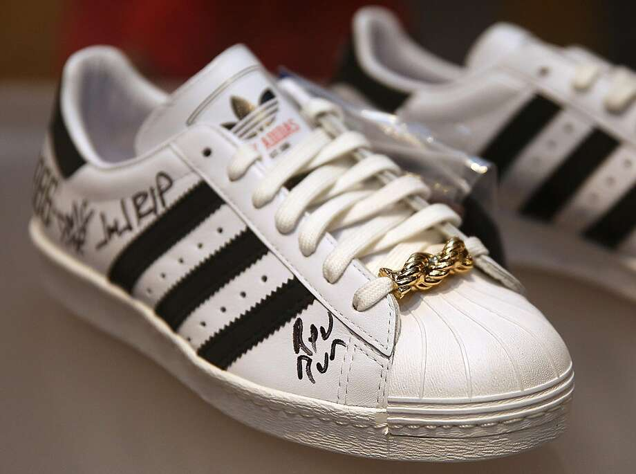 The 25th Anniversary Superstar Adidas, 2011, autographed by Rev Run and DMC displayed at the Oakland Museum of California as it presents 'Out of the Box: The Rise of Sneaker Culture' which explores the design evolution of sneakers on Thursday, December 22, 2016, in Oakland, Calif. Photo: Liz Hafalia, The Chronicle