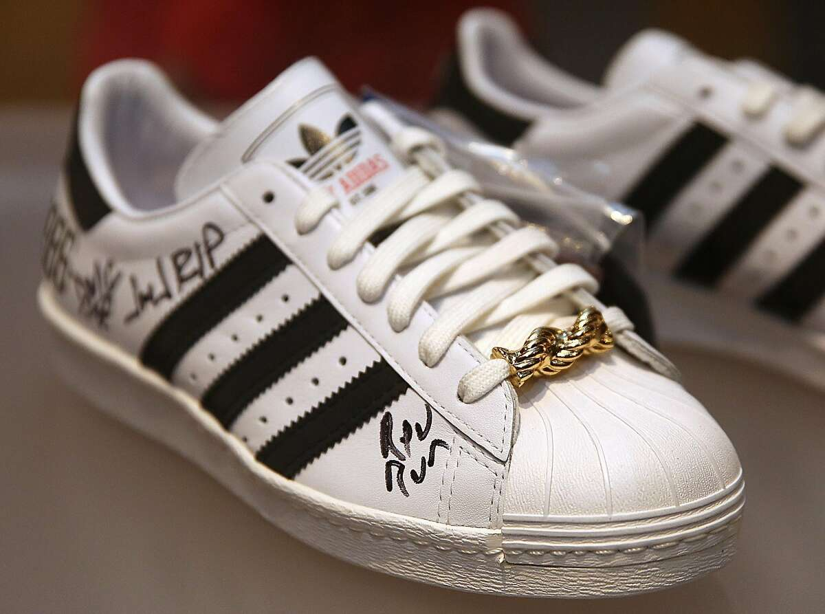 The 25th Anniversary Superstar Adidas, 2011, autographed by Rev Run and DMC displayed at the Oakland Museum of California as it presents 'Out of the Box: The Rise of Sneaker Culture' which explores the design evolution of sneakers on Thursday, December 22, 2016, in Oakland, Calif.