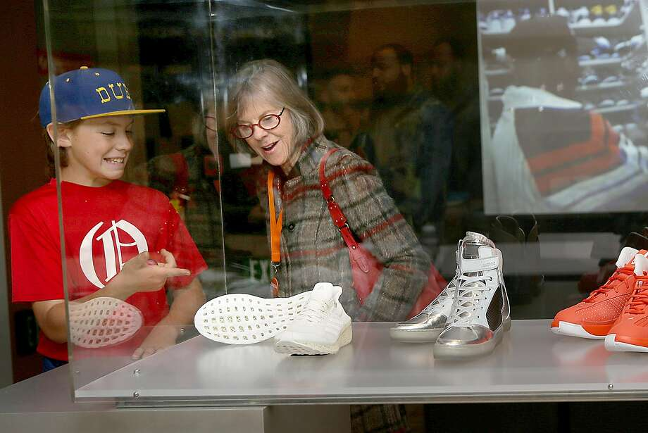 Joe Shallat, 11, and grandmother Judy Shallat check out the Oakland museum's exhibition on sneakers. Photo: Liz Hafalia, The Chronicle