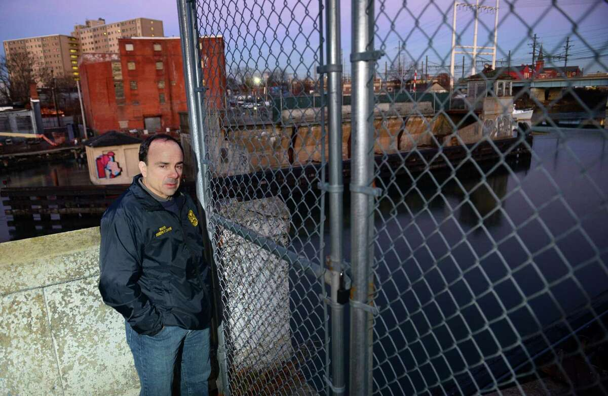 Mayor Joe Ganim stands on the former Congress Street road and drawbridge in Bridgeport, Conn., on Tuesday Dec. 20, 2016. Ganim is pledging to try and rebuild the torn down bridge, possibly with a causeway, to better connect the East Side to downtown.