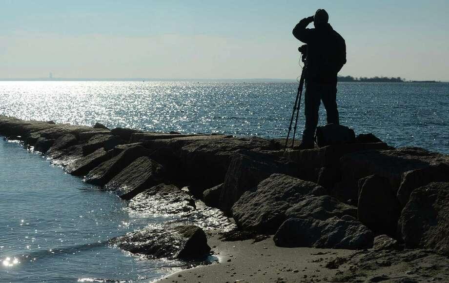 Photographer Preston Ehrler frames up a shot at Compo Beach Wednesday in Westport. Photo: Erik Trautmann / Hearst Connecticut Media / Norwalk Hour