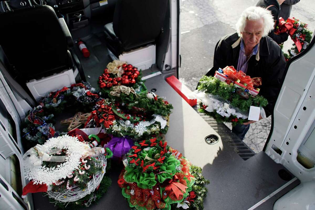 Frank DiPietro, maintenance coordinator, unloads some of the Times Union Circles of Caring Contest wreaths at the Visiting Nursing Association on Thursday, Dec. 15, 2016, in Albany, N.Y. (Paul Buckowski / Times Union)