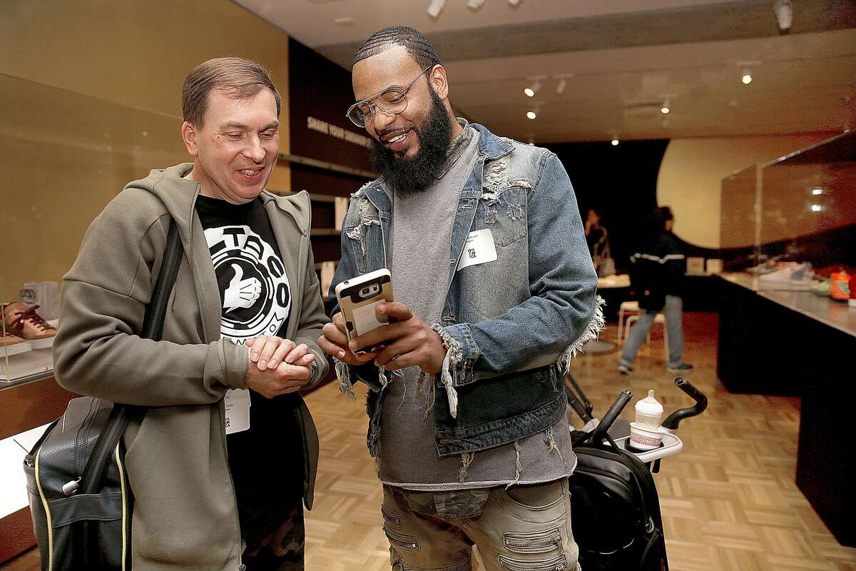 Shoe designer Steve Smith (left) talks with shoe designer/customizer Devlin Braswell (right) from Fairfield at the Oakland Museum of California as it presents Out of the Box: The Rise of Sneaker Culture which explores the design evolution of sneakers on Thursday, December 22, 2016, in Oakland, Calif. Steve Smith created the Reebok Instapump Fury over 20 years ago.