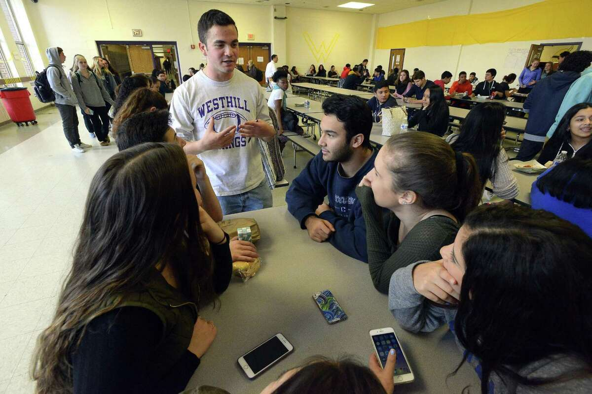 Noah Klein, Student Ombudsman for Westhill High School student newspaper Westword chats with students during lunch.