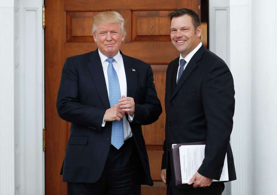 In this Nov. 20, 2016 photo, President-elect Donald Trump pauses for photographs as he greets Kansas Secretary of State, Kris Kobach, at the Trump National Golf Club Bedminster clubhouse, in Bedminster, N.J. (AP Photo/Carolyn Kaster) Photo: Carolyn Kaster, STF / Copyright 2016 The Associated Press. All rights reserved.