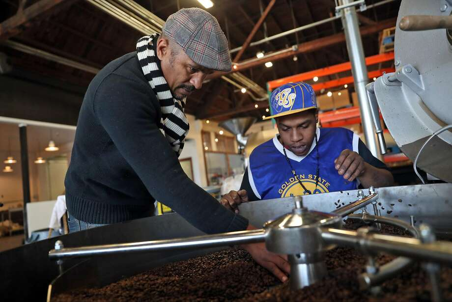 Keba Konte and employee Solomon Tyson check quality of roasted coffee beans at Red Bay Coffee in Oakland. Konte says he's gotten calls in the wake of the Starbucks incident. Photo: Scott Strazzante / The Chronicle 2016