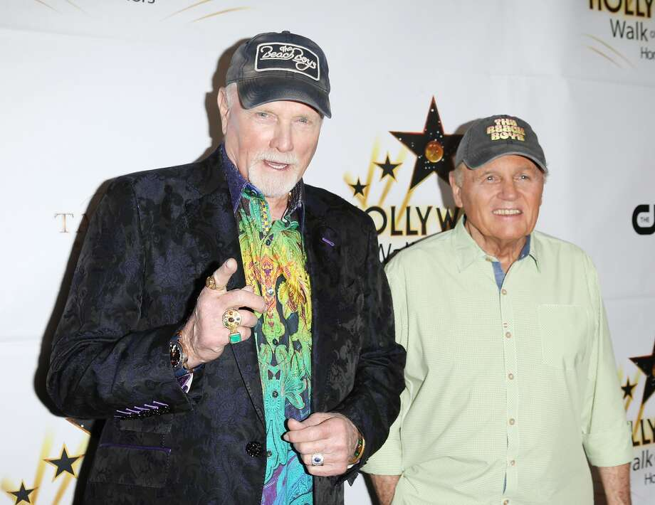 Musicians Bruce Johnston and Mike Love of The Beach Boys perform onstage during the Hollywood Walk of Fame Honors at Taglyan Complex on October 25, 2016 in Los Angeles.