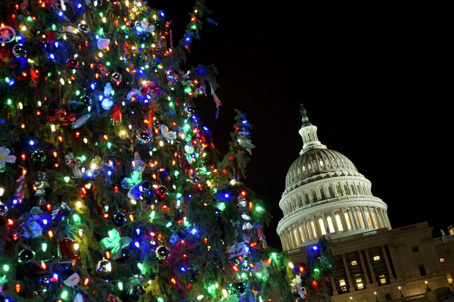 U.S. Capitol is seeing behind the Christmas Tree in Washington, Wednesday, Dec. 14, 2016. ( AP Photo/Jose Luis Magana) Photo: Jose Luis Magana, FRE / FR159526 AP