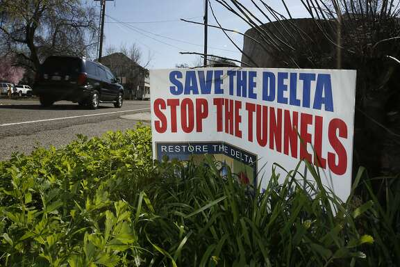 In this Tuesday, Feb. 23, 2016 photo, a sign opposing a proposed tunnel plan to ship water through the Sacramento-San Joaquin River Delta to Southern California is displayed near Freeport, Calif. (AP Photo/Rich Pedroncelli)