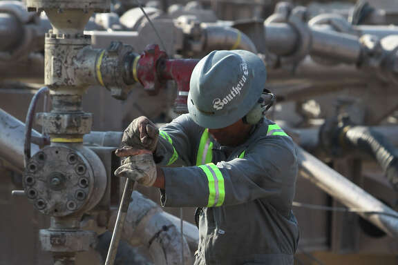 An oilfield employee works at a Talisman Energy fracking site near Cotulla, Texas in 2011. JOHN DAVENPORT/SAN ANTONIO EXPRESS-NEWS/jdavenport@express-news.net