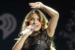 Recording artist Ally Brooke of Fifth Harmony performs onstage during 106.1 KISS FM's Jingle Ball 2013 at American Airlines Center on December 2, 2013 in Dallas, Texas.  (Photo by Christopher Polk/Getty Images for Clear Channel)