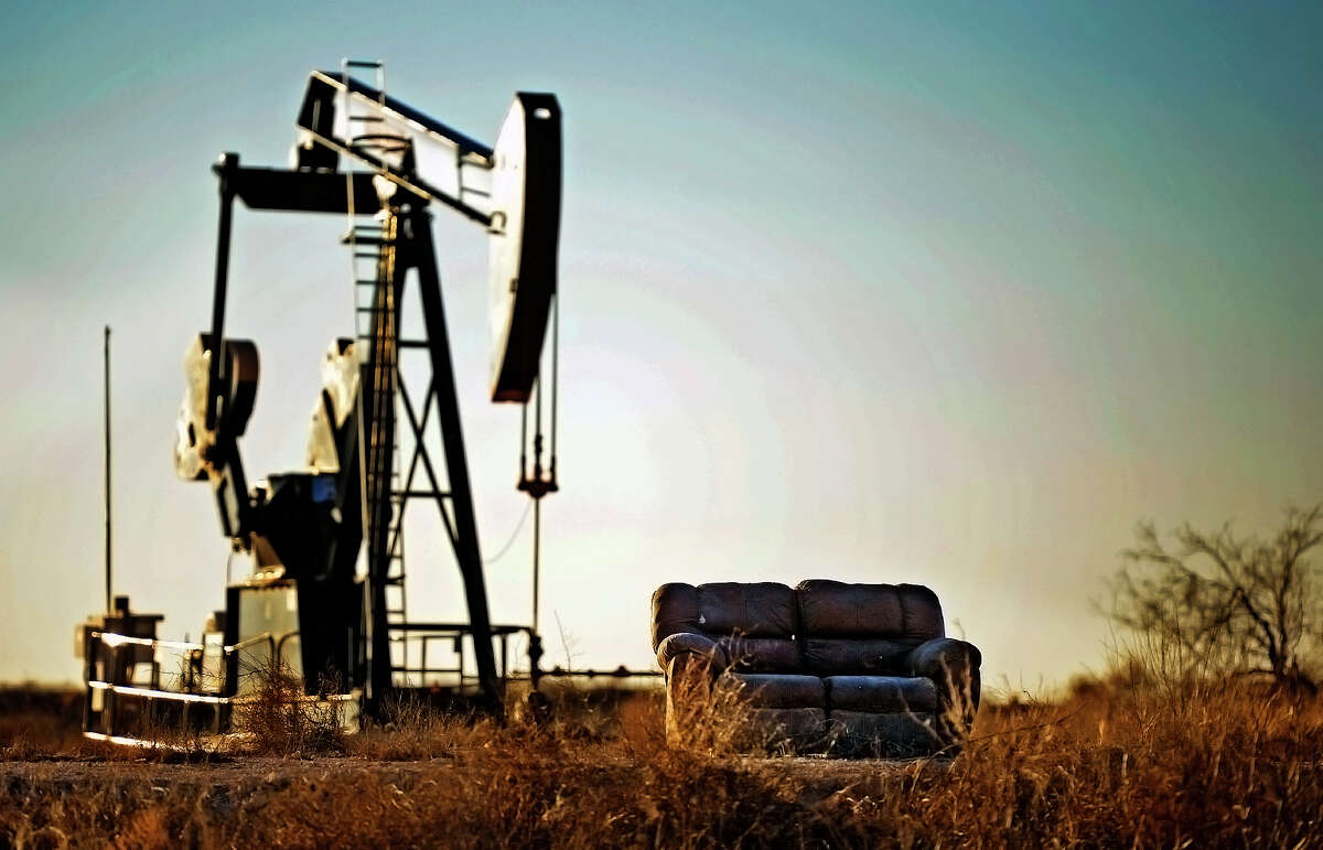 A couch sits near a pump jack on East County Road 90 in Midland, Texas, on Saturday, Jan. 9, 2016. James Durbin/Reporter-Telegram