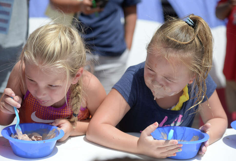 Krista Law, age 5, and Abigail Lindsey, age 6, compete in an ice cream eating contest during an Ice Cream Festival hosted by Do 432 featuring inflatable water slides from Tiki Island Waterpark, Saturday, July 30, 2016, in a parking lot near S. Big Spring Street and W. Kentucky Ave. James Durbin/Reporter-Telegram Photo: James Durbin