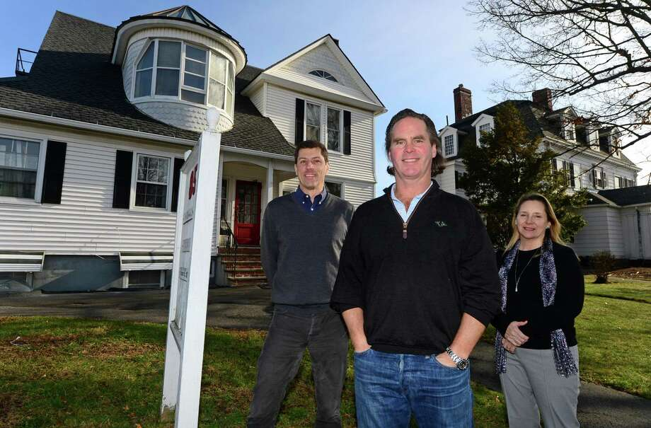 Local developer Bradford Craighead, center, and his architect, Martin Marciano, and real estate agent, Leslie Ann Soyland, Tuesday, December 13, 2016, in front of one of their development projects at 85-87 East Ave. in Norwalk, Conn. Craighead is taking advantage of some of the city's aging residential properties, purchasing them and renovating them into unique multi-unit apartment buildings. Photo: Erik Trautmann / Hearst Connecticut Media / Norwalk Hour