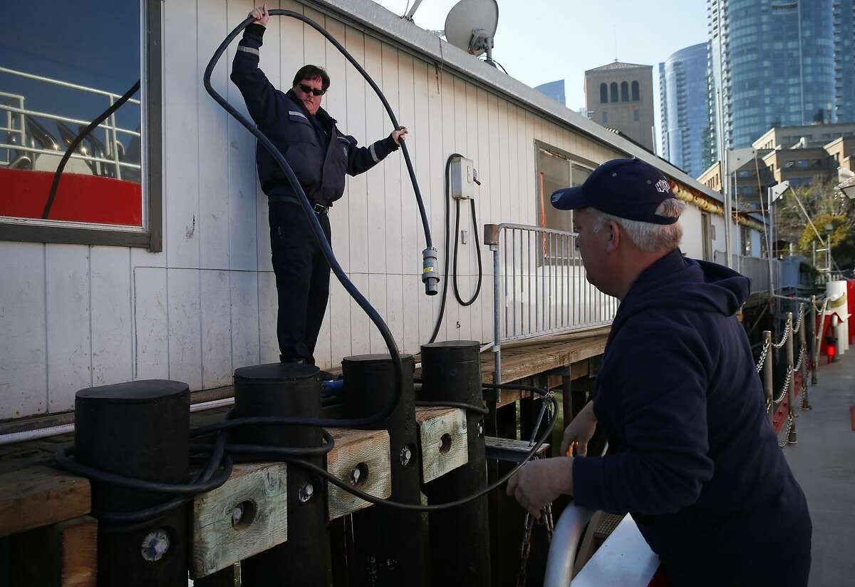 Lt. Raul Francisco, left, helps Engineer Mike Shaw ready the St. Francis fireboat for a short trip for the San Francisco Chronicle to photograph the pier at Fire Station 35 at Pier 22 1/2 Dec. 22, 2016 in San Francisco, Calif.
