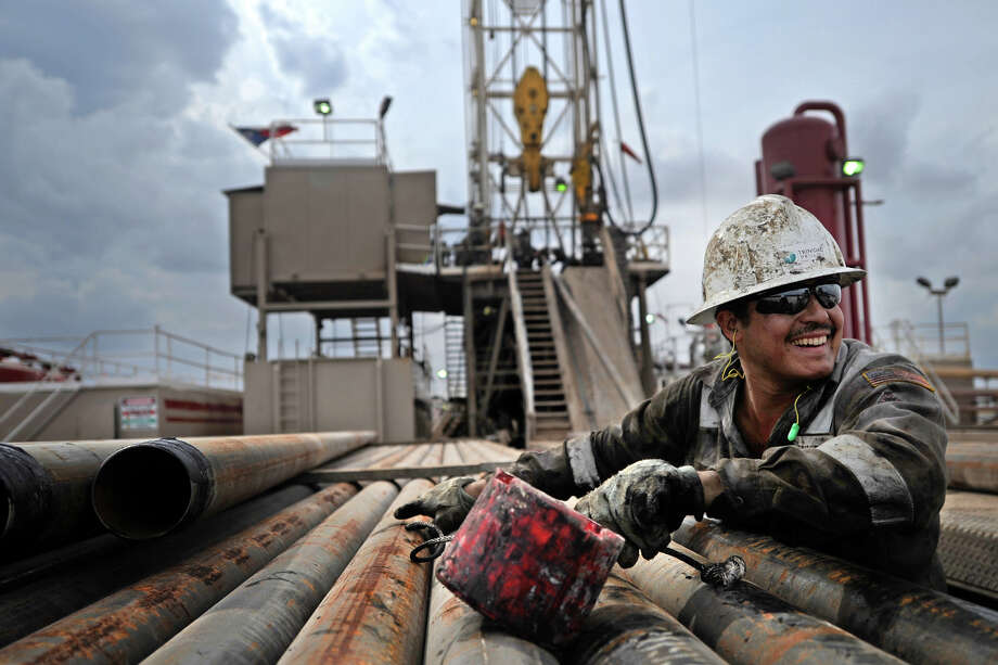 Charles Robertson, a floor hand with Trinidad Drilling, jokes with a coworker while moving casing on a rack near Trinidad Drilling Rig 433 on Wednesday, Nov. 2, 2016, in Midland County. James Durbin/Reporter-Telegram Photo: James Durbin
