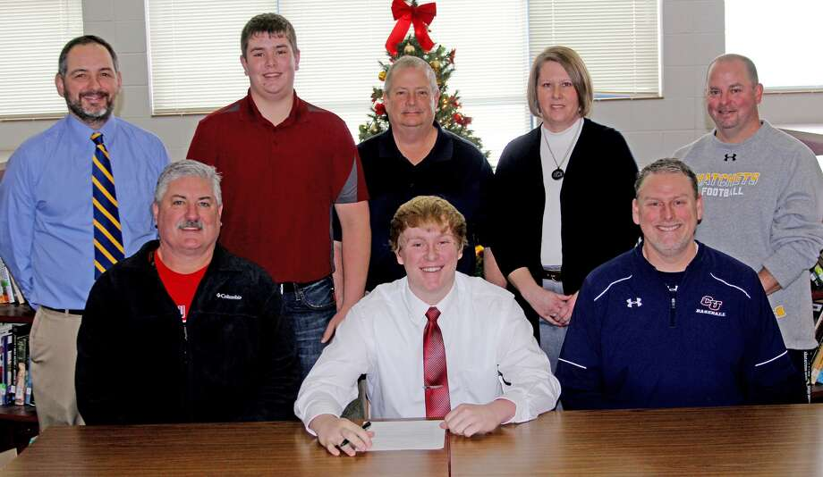 Bad Axe's Brandon Erla inked his letter of intent to Cleary University earlier this week. Joining Erla at the signing were, front from left, Bad Axe varsity head coach Bob Breault and Cleary University head coach Karl Kling. Back row, from left, Bad Axe varsity assistant coach Brad Roth, brother Michael Erla, dad Bob Erla, mom Dawn Erla and Bad Axe junior varsity coach Ron Johnston.