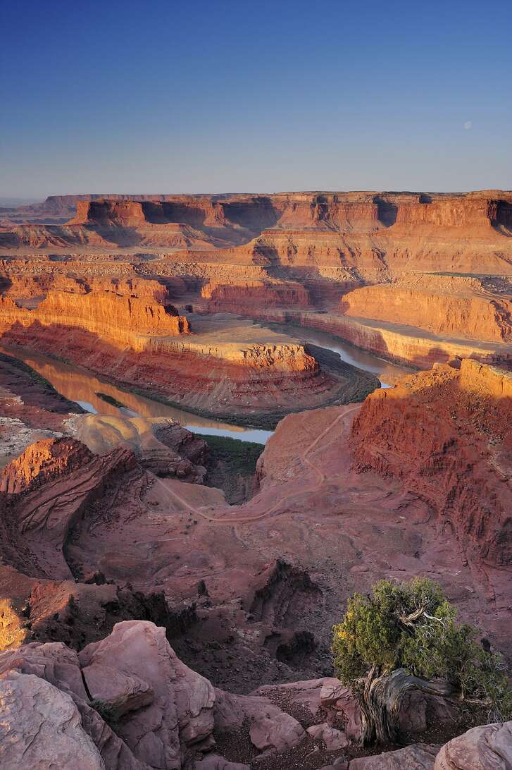 Sunrise at Dead Horse Point in Canyonlands National Park with view to Colorado River.