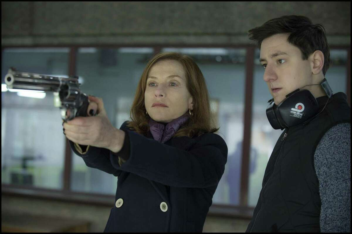 """Isabelle Huppert, left, and Arthur Mazet in a scene from """"Elle,"""" a striking collaboration between French actress Huppert and Dutch director Paul Verhoeven."""