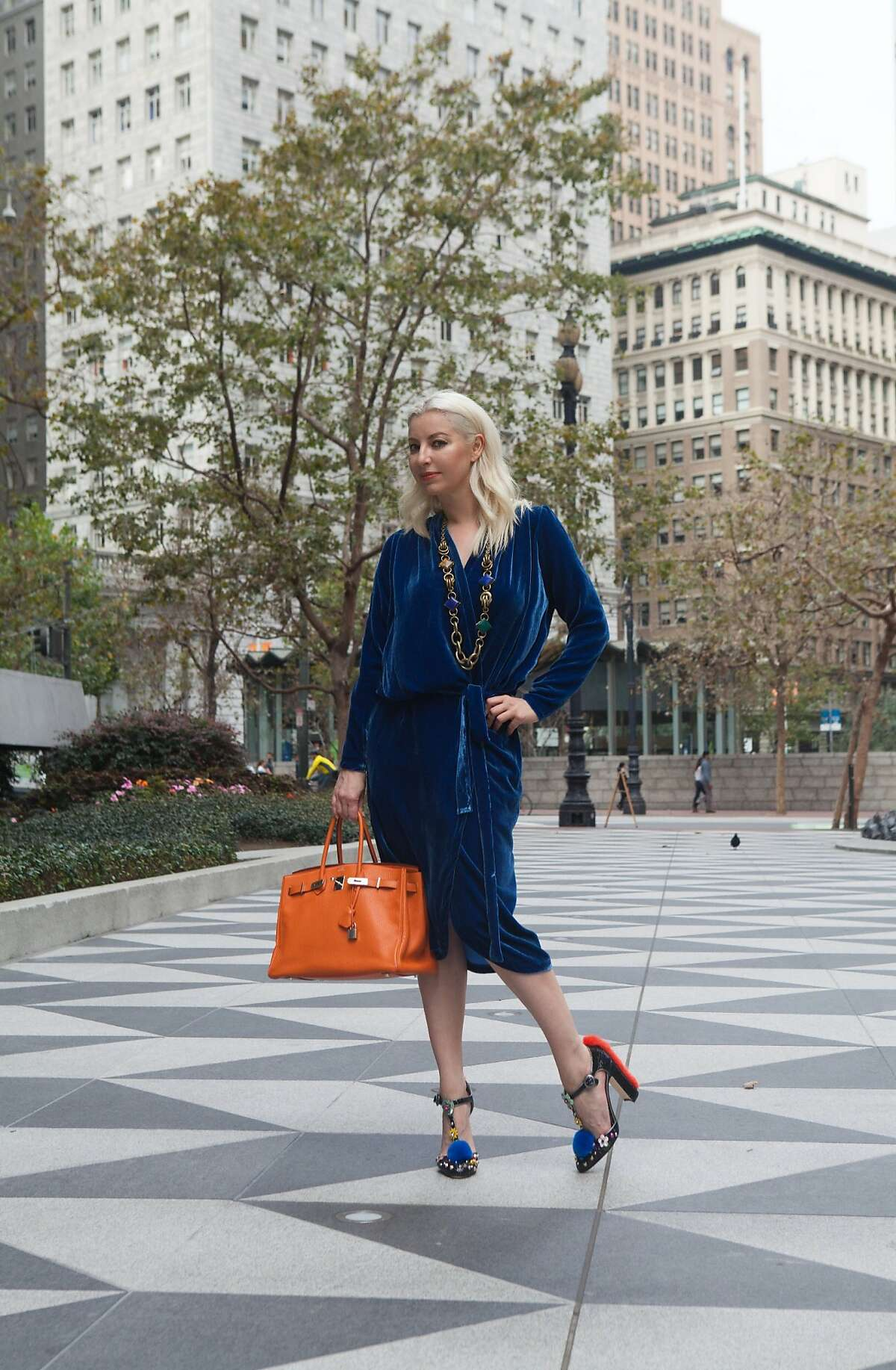 """San Francisco's Sonya Molodetskaya (seen here in a robe dress, $450, of her own design) in December 2016 launched a fashion line called """"Major Obsessions"""" in collaboration with Altana Danzhalova. It features tops and dresses based on seasonal trends, and manufactured in San Francisco. Prices range from $380 to $550, www.majorobsessions.com"""
