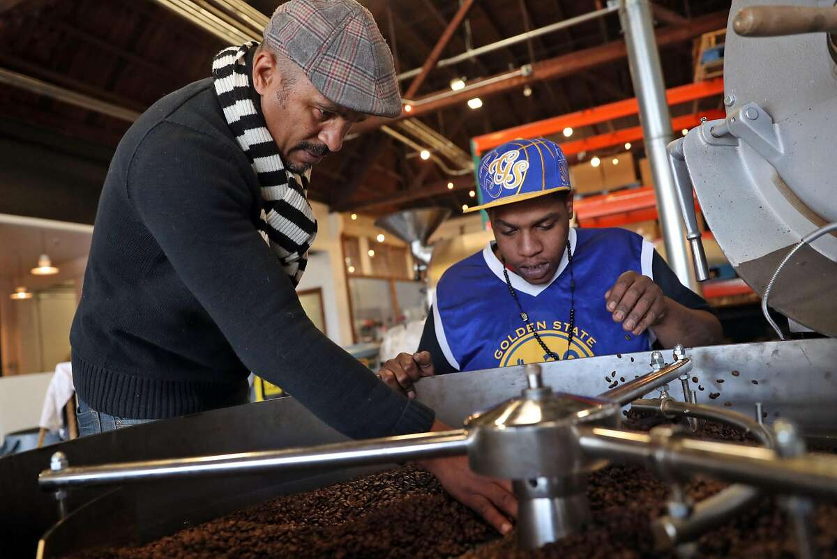 Keba Konte and employee Solomon Tyson check quality of roasted coffee beans at Red Bay Coffee in Oakland, Calif., on Thursday, December 22, 2016.