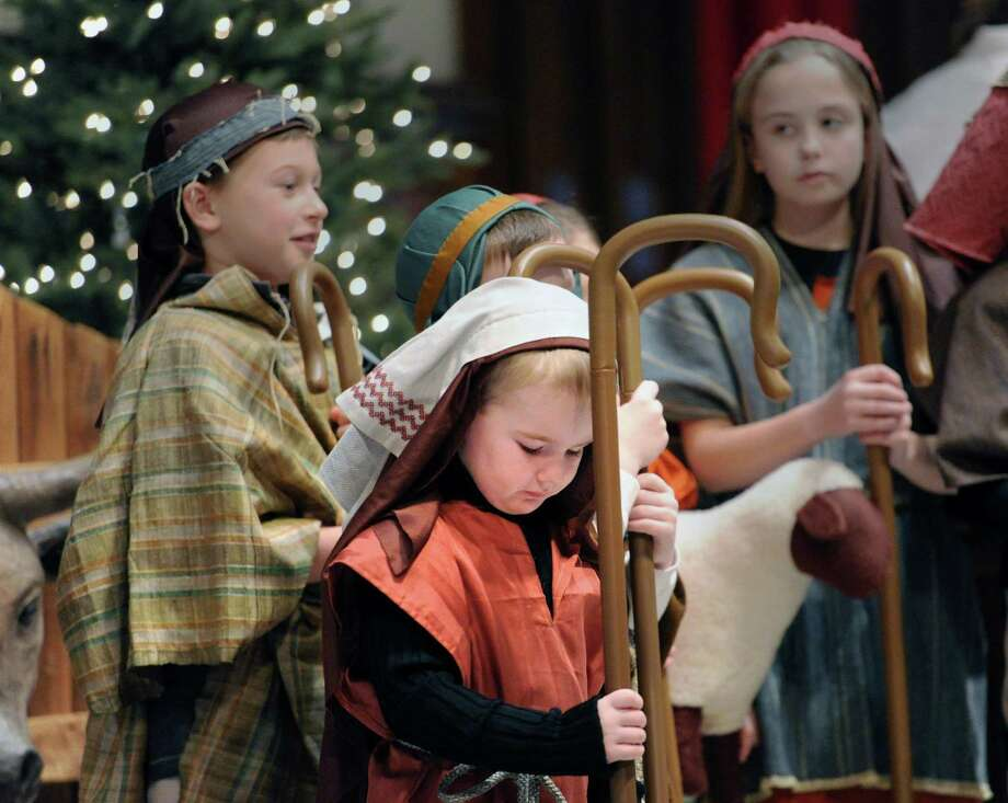 At center, Stepehn Gettings, 4, of Old Greenwich, was a shepherd in the Nativity Pageant during the Children's Christmas Eve service at the First Congregational Church in Old Greenwich, Conn., Wednesday, Dec. 24, 2014. Photo: Bob Luckey / Bob Luckey / Greenwich Time