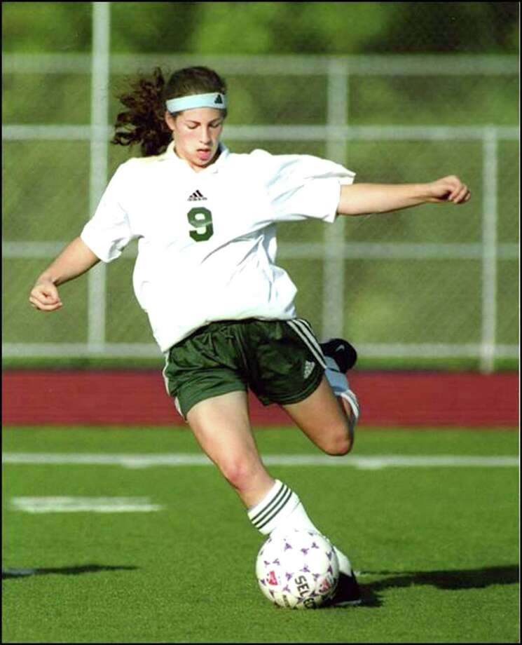 Chelsea Cohen of Norwalk High boots a ball during her high school career more than a decade ago. The Chelsea Cohen Scholarship has been established more than a decade after her death from cancer. Photo: Contributed Photo / Hearst Connecticut Media / Norwalk Hour