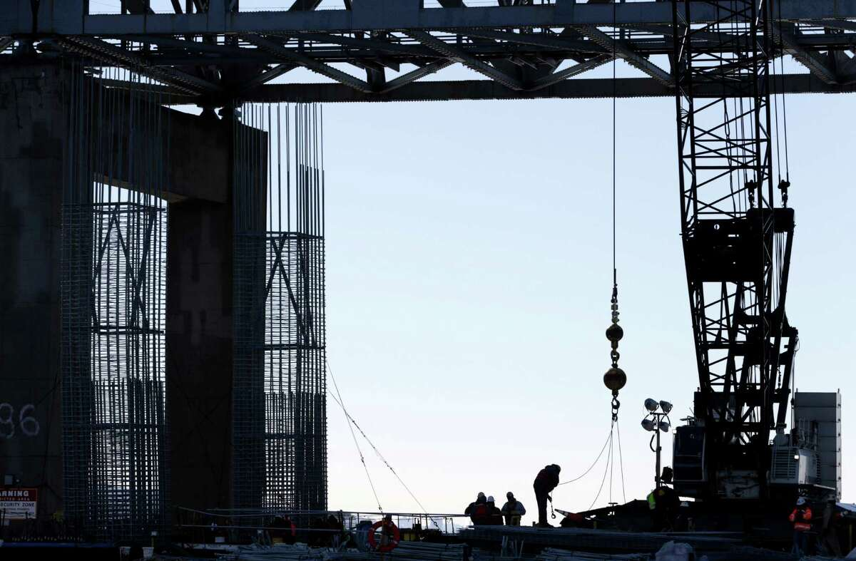 Work continues on the new Tappan Zee Bridge near Tarrytown, N.Y., Tuesday, Dec. 20, 2016. The concrete needed for New York?'s new, $4 billion Tappan Zee Bridge, under construction over the Hudson River, would be enough to make a 1,500-mile sidewalk reaching all the way to Florida?'s Key West. (AP Photo/Seth Wenig) ORG XMIT: NYSW102