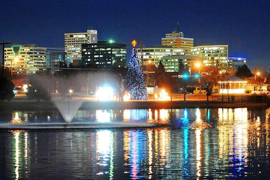 Christmas tree, duck pond and downtown Midland photographed at night, Wednesday, Dec. 21, 2016. James Durbin/Reporter-Telegram Photo: James Durbin