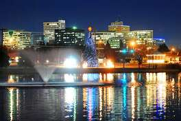 Christmas tree, duck pond and downtown Midland photographed at night, Wednesday, Dec. 21, 2016. James Durbin/Reporter-Telegram