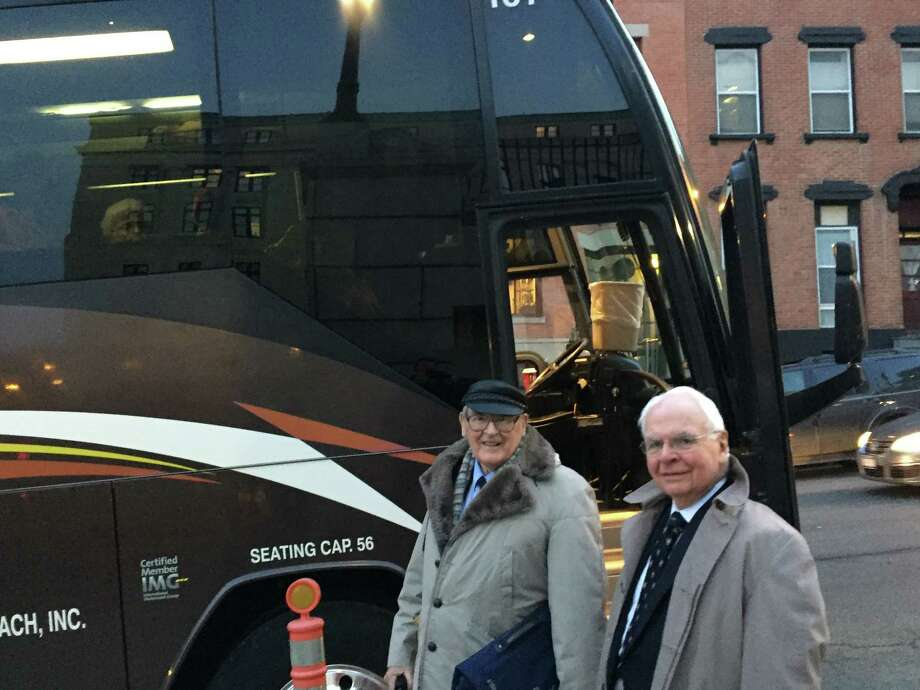 Arthur Casey, right, was among 47 senior citizens from Coburg Village in Rexford who rode a bus to Albany on Wednesday expecting to hear arguments about a lawsuit filed by state Attorney General Eric Schneiderman against the managers of their housing complex. (Robert Gavin / TImes Union)