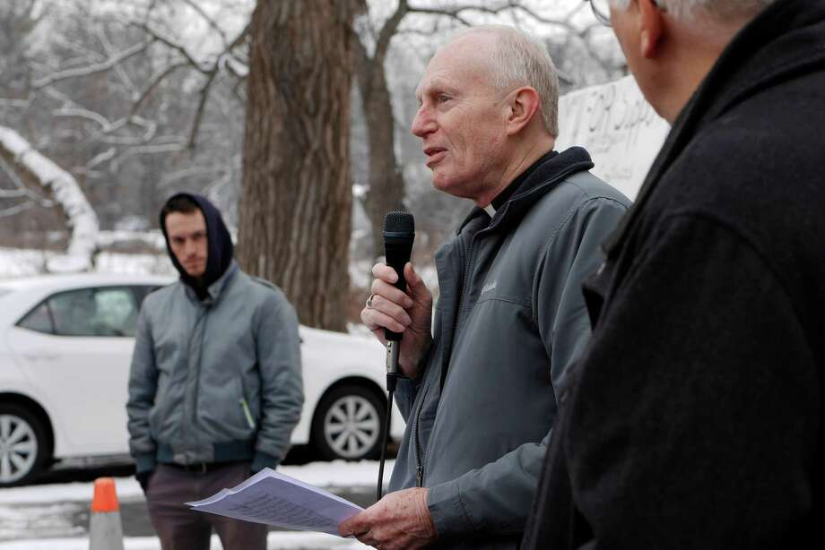 Bishop Emeritus Howard Hubbard helps to lead a religious service outside of Momentive Performance Materials on Thursday, Dec. 22, 2016, in Waterford, N.Y.  Religious leaders from the Capital Region held the service to show support for the workers of Momentive who have been on strike for over seven weeks.      (Paul Buckowski / Times Union) Photo: PAUL BUCKOWSKI / 20039220A