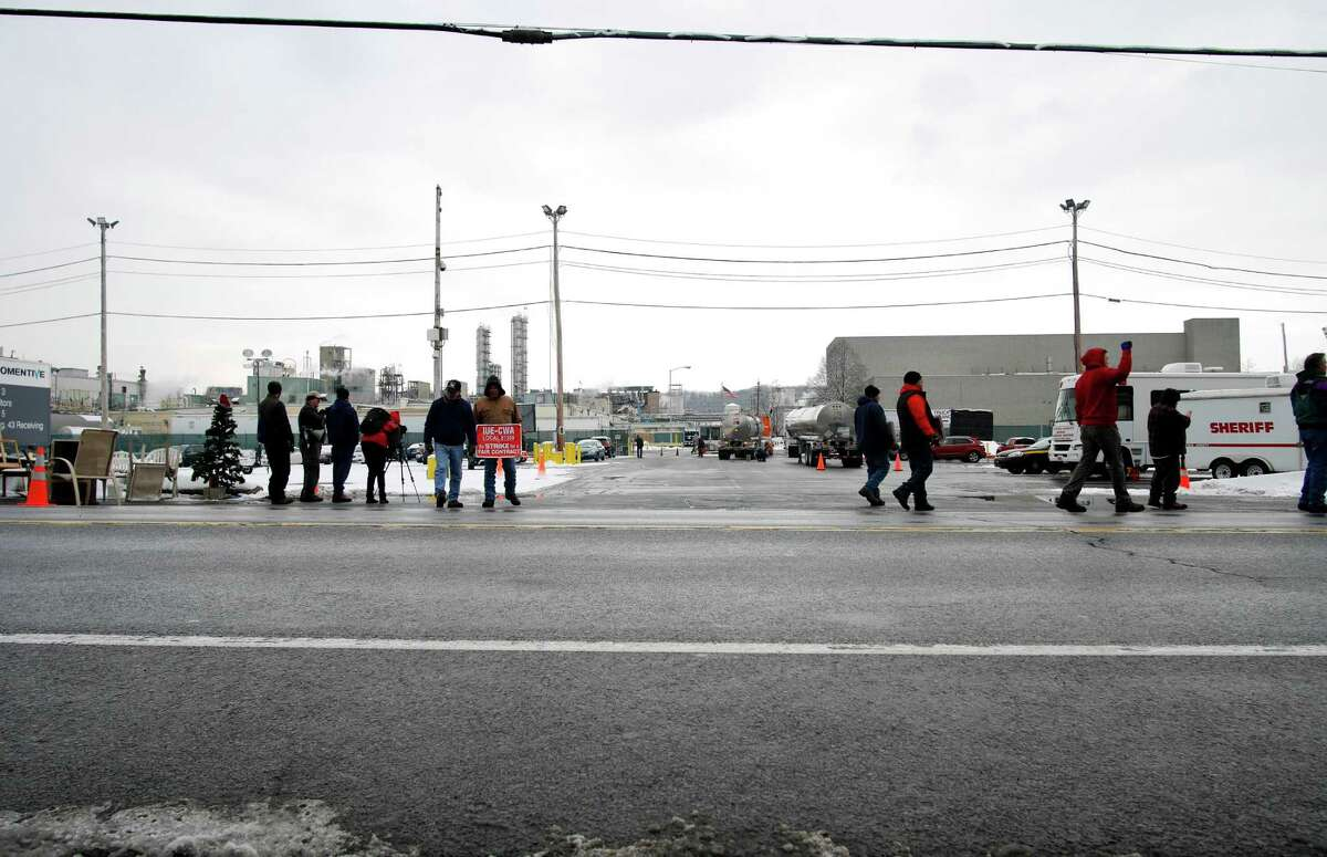 Workers walk a picket line outside of Momentive Performance Materials on Thursday, Dec. 22, 2016, in Waterford, N.Y. Religious leaders from the Capital Region held a service outside the plant on Thursday to show support for the workers of Momentive who have been on strike for over seven weeks. (Paul Buckowski / Times Union)