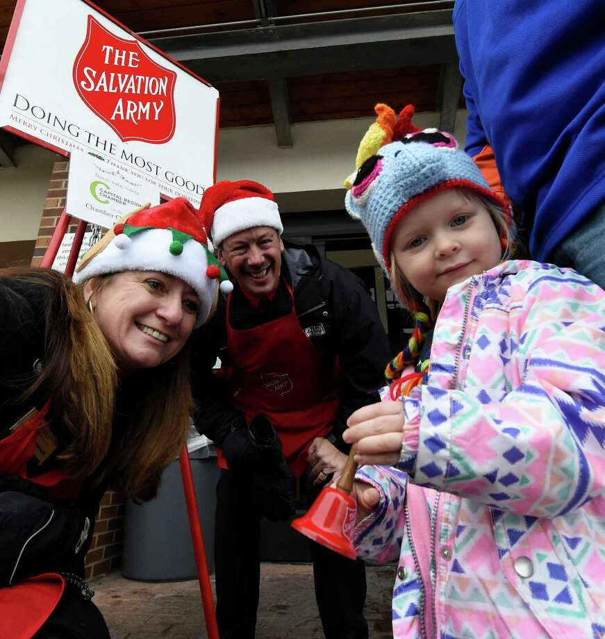 Regional Chamber of Commerce members Kyle Schoonmaker of Berkshire Hathaway, left and Roderick Sipe of Goldstein Motors ring the bells in front of the Market 32 Bistro for the Salvation Army with the assist from Molly Matott, 3 of Latham  Thursday Dec. 22, 2016 in Latham, N. Y  (Skip Dickstein/Times Union) Photo: SKIP DICKSTEIN / 20039229A