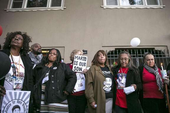 Center: Gwen Woods, who is the mother of Mario Woods, stands with mothers whose children have been killed by law enforcement, during an event commemorating the one-year anniversary of Mario Woods' death, Friday, Dec. 2, 2016 in San Francisco, Calif.