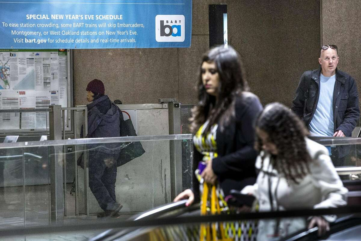 A woman exits the Embarcadero BART Station through the emergency gate on Thursday, Dec. 22, 2016 in San Francisco, Calif.