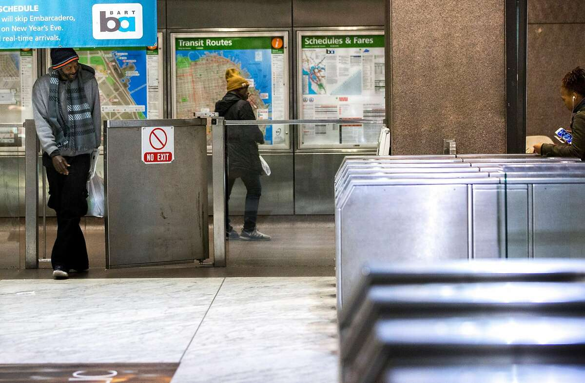 A man walks into the Embarcadero BART Station through the emergency gate on Thursday, Dec. 22, 2016 in San Francisco, Calif.