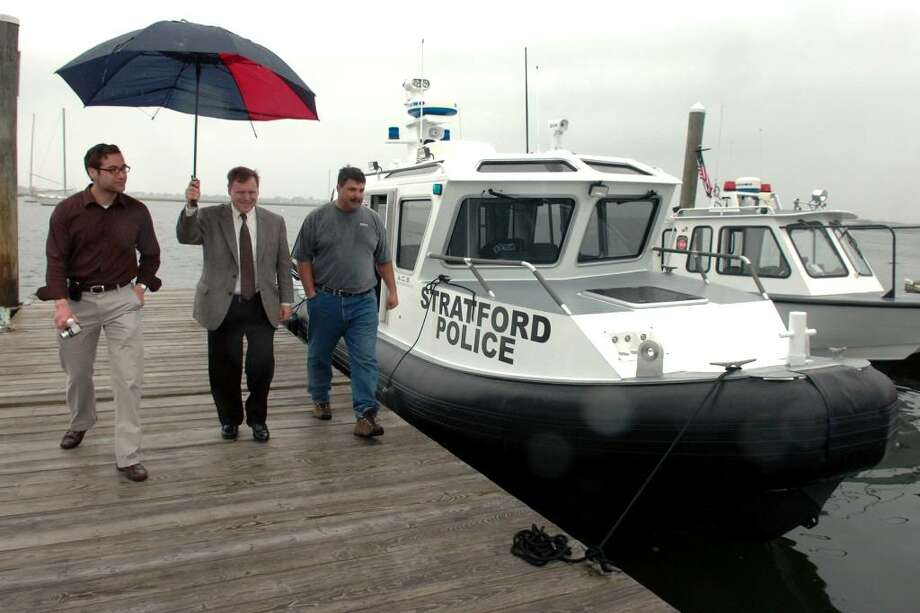 Mayor John Harkins (center) walks with his Chief of Staff, Adam Bauer (left), and Assistant Fire Chief Dan Ross (right), as they view the Stratford Police Department's new boat Monday, May 24th, 2010, in Stratford, Conn. Mayor Harkins has proclaimed May through October as safe boating and paddle smart months in the Town of Stratford. Photo: Ned Gerard / Connecticut Post