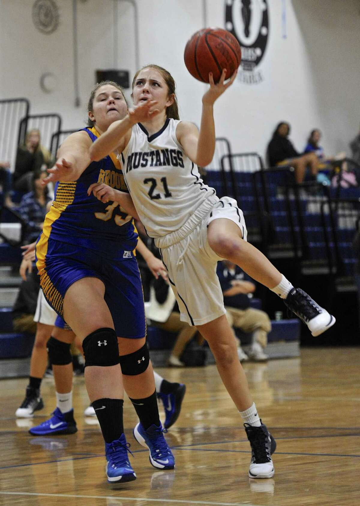 Immaculate's McKinsey Jarboe (21) drives to the basket past Brookfield's Lindsey Zaleski (35) during their basketball game Thursday night at Immaculate High School.
